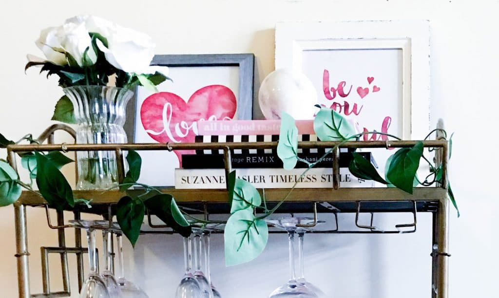 Pretty in the Pines, Shelby Vanhoy, Home Decor, Gold Bamboo Bar Cart, gold affordable bar cart, target bar cart, serving cart, Valentine's Day Decor Ideas, Valentine Bar Cart, Galentine's Day Party Decor Ideas, Decorate Bar Cart for Valentines Day, styled bar cart, how to style bar cart for valentine's day, watercolored prints for valentine's day and valentine's day, faux flowers, flower arrangements