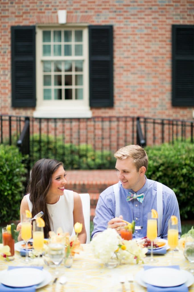 Wedding brunch ideas, brunch decor, the carolina inn, whiskey and white events, blue barn photography, pretty in the pines, north carolina blog, vineyard vines, high cotton bowtie, pastel bowtie, bloody mary engagement party, bridal brunch, white romper, ASOS, groom suspenders, outfit, styled shoot