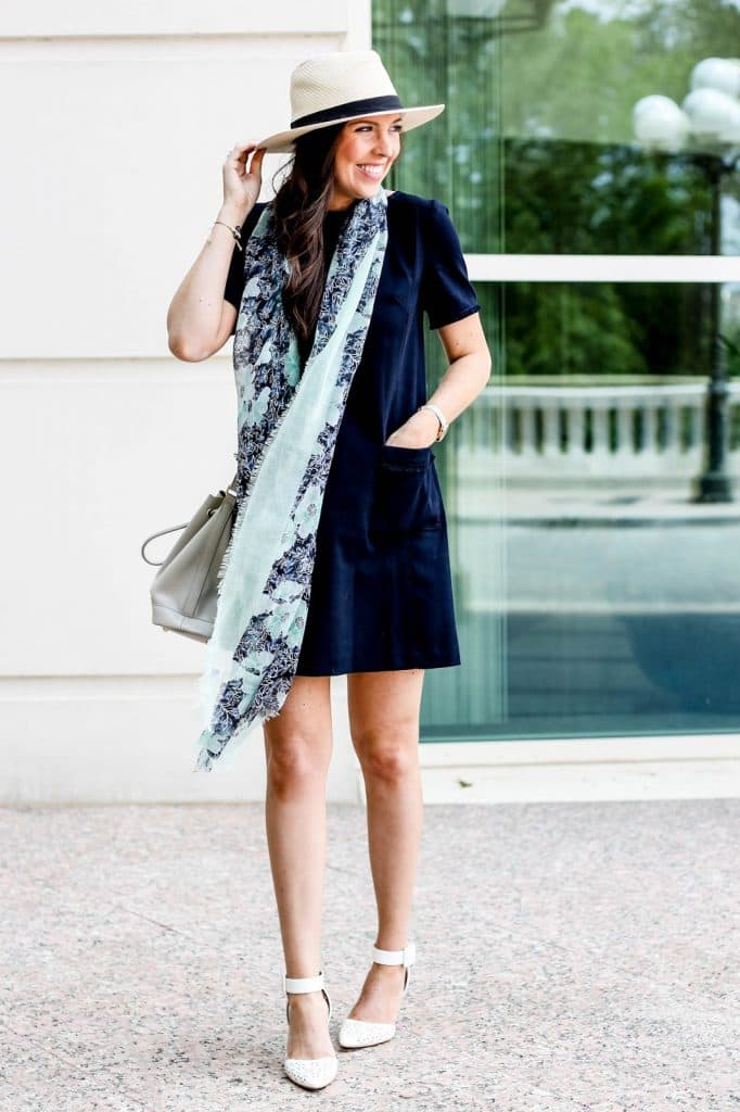 Fedora, Navy blue dress, fringed dress, fringed shift dress, LOFT fringed shift dress, washed floral scarf, patterned scarf for spring, cute spring outfit idea, poverty flats by rian bucket bag, sam edelman pointy toe pumps ankle strap, pretty in the pines, fashion blogger, north carolina blogger, fossil watch