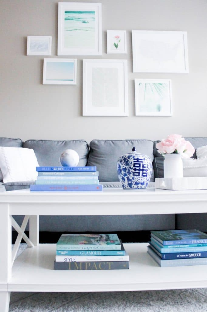 gallery wall, minted art, white frames, white coffee table, pottery barn coffee table, grey sectional sofa, gray sofa, how to create a gallery wall, nature inspired gallery wall, white and grey living room decor, decor ideas, pretty in the pines