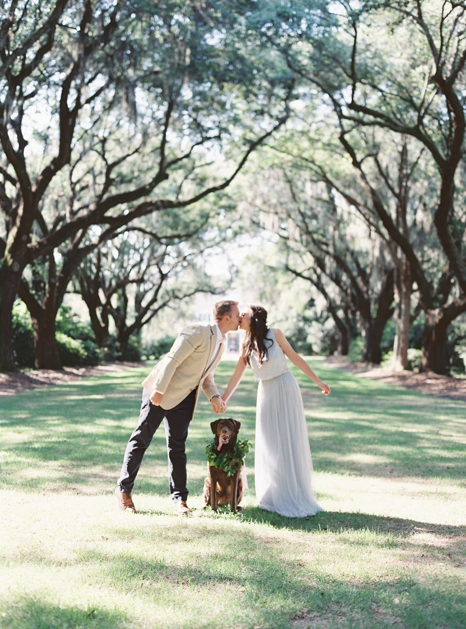 charleston engagement photos, legare waring house, donna morgan bridesmaid dress two piece, dog floral crown, dog greenery, engagement photo outfit, charleston wedding venue, pretty in the pines blog, style me pretty blogger bride, charleston wedding, jake and heather photography, miele events, meg workman hair and makeup