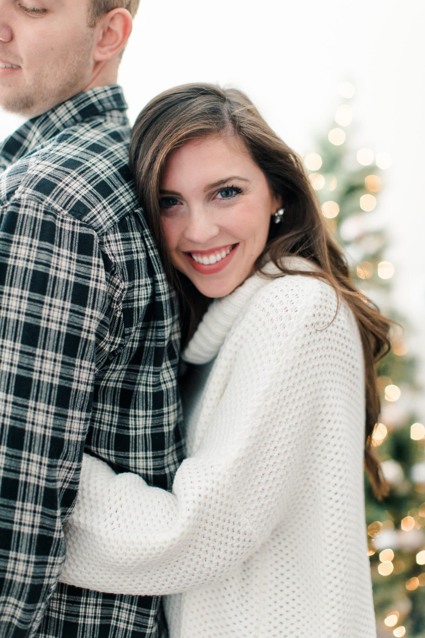 winter photography christmas photo idea, indoor cozy photoshoot, engagement photos, pretty in the pines, christmas apartment decor ideas, north carolina lifestyle travel blog, bluebarn photography, christmas card