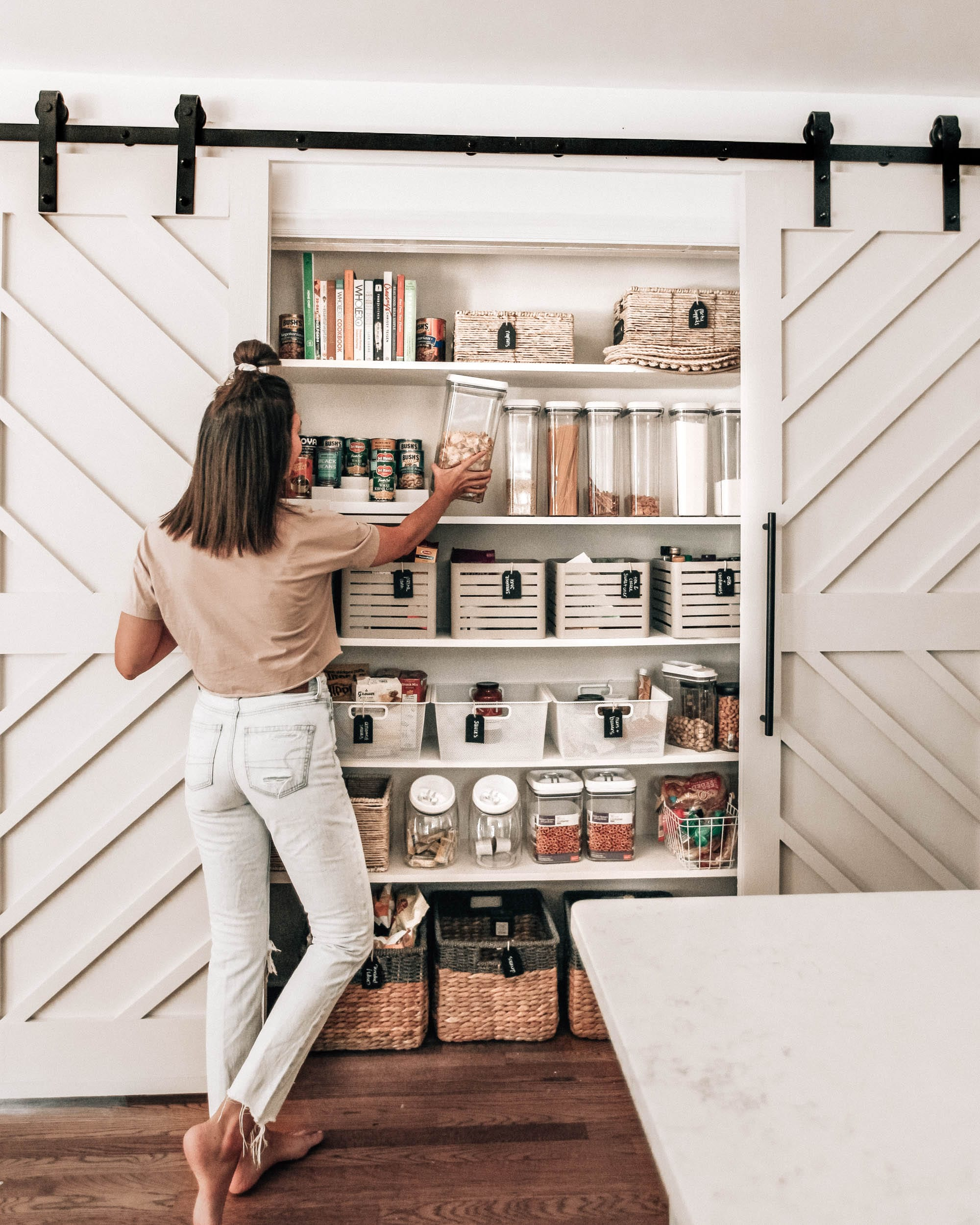 New Home Decor Ideas by popular Washington D.C. life and style blogger, Alicia Tenise: image of an organized pantry with sliding barn doors.