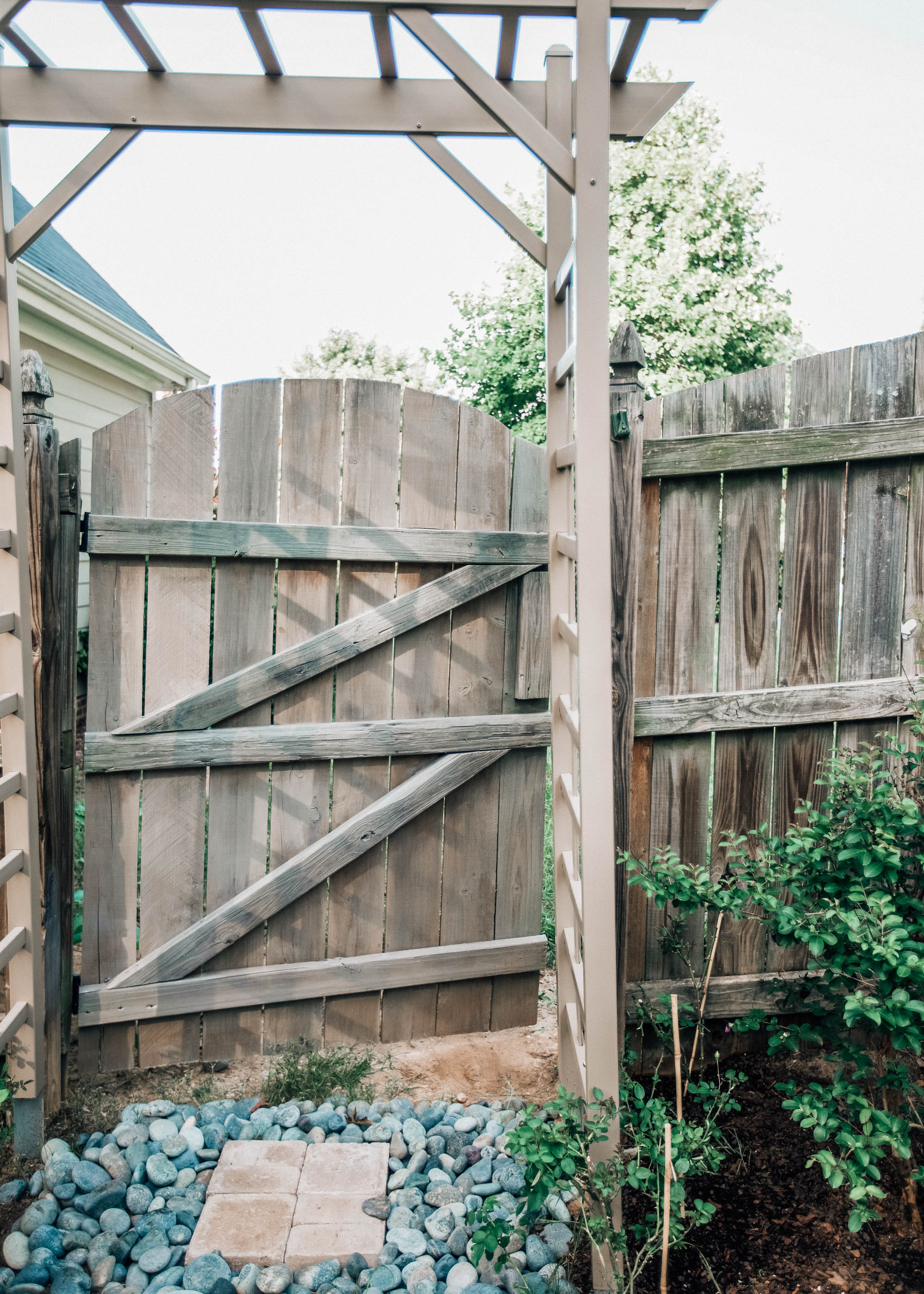 A New Landscaping Project: Staining Our Backyard Fence